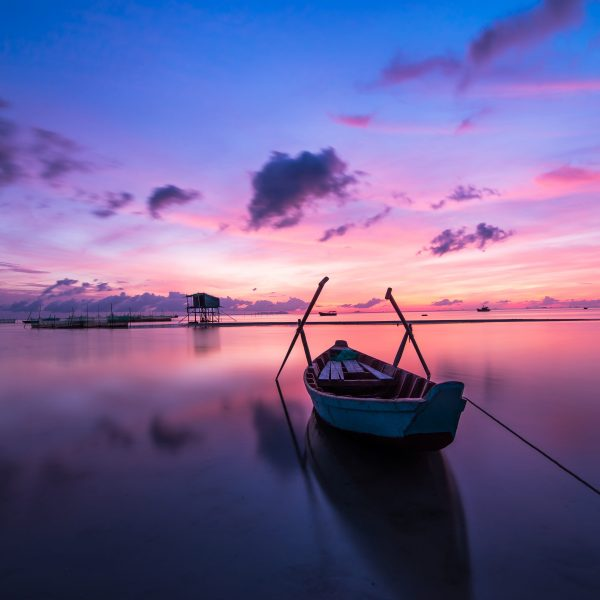 lone boat and colorful sunset